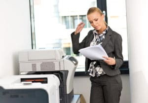 woman working on copy machine