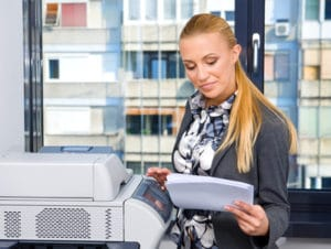 woman secretary with copy machine